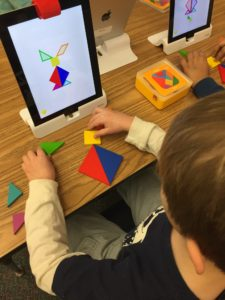 Picture of student using iPad with Osmo tangrams